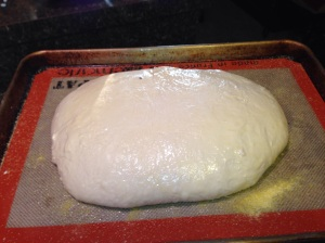 The dough round is rising for a second time for 3 hours.
